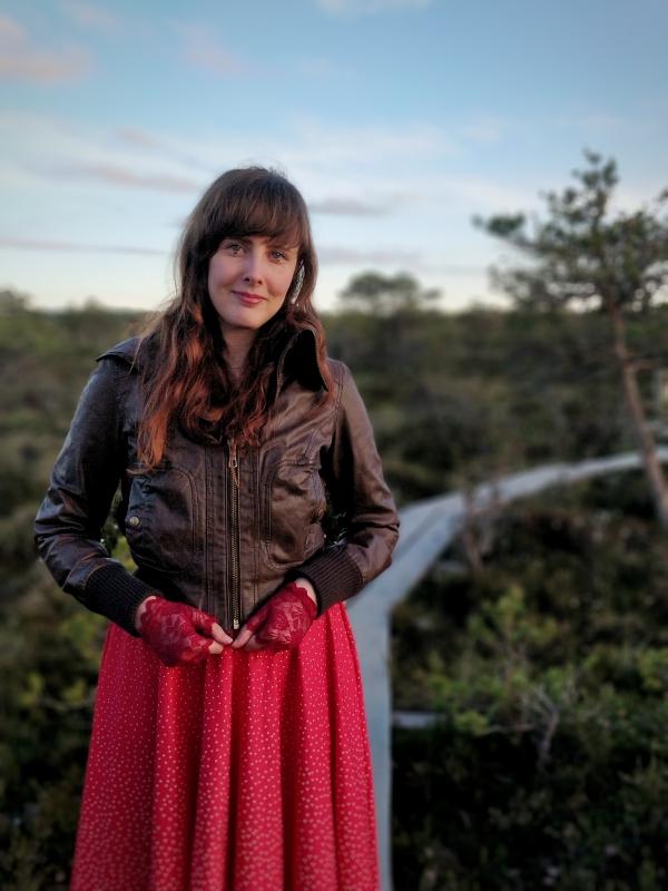 Silvi standing at a marshlands track